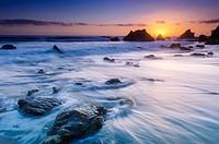 Sea stacks at sunset, El Matador State Beach, Malibu, California USA.