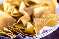 A bowl of tortilla corn chips, close up.