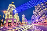 Grassy building and Gran Via street at Christmastime. Madrid. Spain.