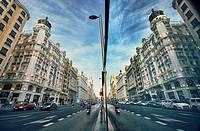 Reflection on a window in Gran Via Avenue. Madrid. Spain.