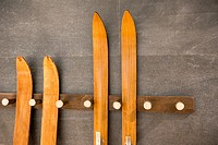 Old wooden skis resting on a wall as a decoration
