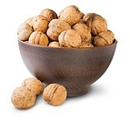 Walnuts In A Clay Bowl Isolated On White Background.