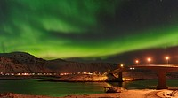 Northern Lights over the bridges of Fredvang (Fredvangbruene) connecting the islands Moskenesoya and Flakstadoya. The Lofoten Islands in northern Norw...