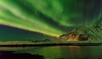 Northern Lights over Flakstadoya. The Lofoten Islands in northern Norway during winter. Europe, Scandinavia, Norway, February.