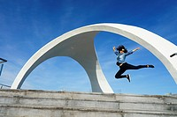 Woman jumping in Viewpoint of La Calica de Aguilas, Murcia, Spain