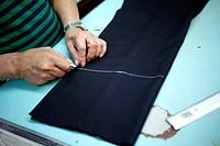 A tailor works in Sastrería Jimenez tailoring shop, Colonia Roma, Mexico City, Mexico.