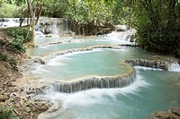 Beautiful streams and waterfalls at the lovely Kuang Si park in Laos.