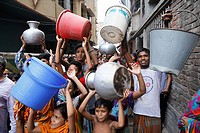 Bangladeshi women and children waiting for drinking water inside the street in Dhaka. Water crisis has been seen in the most under developing and deve...