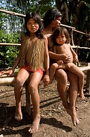 Yagua tribe located near Iquitos, Amazonian, Peru. A Yagua girls with traditional thatch vest, surroundings of Iquitos, Amazonian Peru.