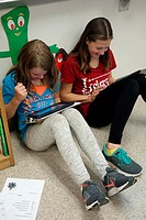 6th Grade Girls Using iPads for Science Research, Wellsville, New York, USA.