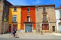 Houses and cyclist, Sarrià de Ter, Girona, Catalonia, Spain