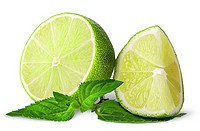 Several pieces of lime with mint isolated on white background.