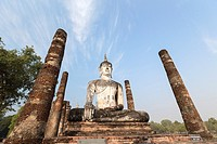 Seated Buddha statue at Wat Mahathat, Sukhothai historical park, Sukhothai, Thailand.