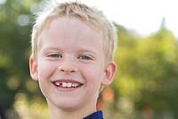 A boy smiling.
