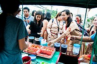 Students at small barbecue and snack stall, Rizal Avenue, Puerto Princesa, Palawan, Philippines