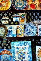 Traditionally decorated plates in shop, Coimbra, Portugal, Europe.