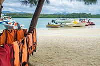 Life jackets hanging out to dry around a tree on the island of Île aux Cerfs, Mauritius, Indian Ocean. Île aux Cerfs is a privately owned island near ...
