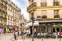 street scene in front of open cafe, rue sainte-croix de la bretonnerie corner rue des archives, marais district, paris, ile de france, France.