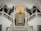 A beautiful symmetrical double staircase in an old building in the Castello district in Cagliari, Sardinia, Italy