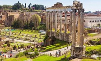 Rome, Italy. The Roman Forum. The three columns in the foreground are those of the Temple of Vespasian. Behind are the columns of the Temple of Saturn...