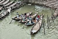 Rowboats at Saderghat on the Buriganga River, Dhaka, Bangladesh.