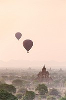 Hot air balloons floating over Bagan temples at sunrise, Bagan, Myanmar.