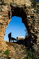 Silhouette of man and dog in the castle of Constantina, Seville province, Andalusia, Spain