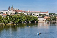 Panorama of Prague with the Cathedral of St. Vitus at the Prague Castle over the Vltava River.