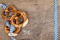 Oktoberfest pretzel on wooden table (copy space).