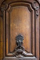 Old ornate door knocker in the Marais district, Paris, Ile-de-France, France.