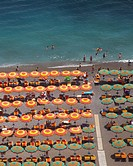 Colorful beach umbrellas in Positano - along the Amalfi Coast, Campania Italy.