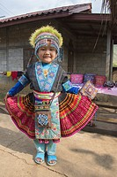 A young girl in traditional Hmong dress in Laos near the Mekong River. 3/16.