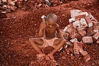 Bangladeshi Child labor break bricks at Postogola brick breaking yard in Dhaka, Bangladesh, on June 3, 2017. With over half of the population living b...