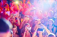Excited people with smartphones during Summer Party at music festival Starbeach in Hersonissos, Crete, Greece, on 09. July 2017