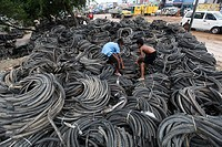 Bangladeshi child laborers handle pieces of old tyres to be recycled in Dhaka. The recycling industry in the Bangladeshi capital plays an important ro...