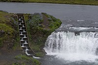 View of the fish ladder at waterfall Faxi (or Faxafoss) in the river Tungufljot in South region of Iceland is part of the golden circle road trip.