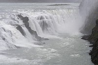 Detail of the Gullfoss (Golden Falls) waterfall in the rain located in the canyon of the Hvita River in southwest Iceland, part of the golden circle r...