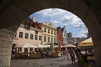 Framed view to the colorful houses in the main Square Raekoja Plats, Tallinn, Estonia, Baltic States, Europe.