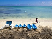 Pedalo and canoes on Mont Choisy beach, Mauritius, Indian Ocean.