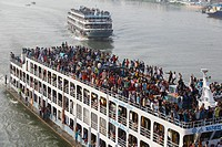 Dhaka, Bangladesh. Desperate Eid-ul- Fitr holidaymakers mount the rooftop of launch to reach their destination at Sadarghat launch terminal in Dhaka. ...