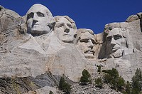 Faces four famous American Presidents at Mount Rushmore South Dakota, Left to right, George Washington, Thomas Jefferson, Theodore Roosevelt, Abraham ...