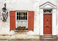 Window Decorated with Flowers and Wood Framed Door in the Charleston Historic District, South Carolina.