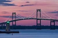 Goat Island Lighthouse and Claiborne Pell Bridge, Newport, Rhode Island.