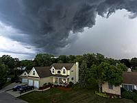 Approaching thunderstorm in a residentail neighborhood aerial view.