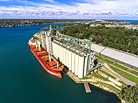 Grain ship taking on wheat at a grain elevator at Sarnia Ontarion Canada bordering Port Huron Michigan on Lake Huron and the St Clair River.