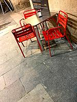 Empty chairs and table in a terrace. Madrid, Spain.