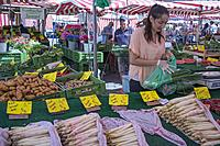 Market stalls in the Hauptmarkt, Nuremberg, Bavaria, Germany. Asparagus in particular is appreciated as a seasonal delicacy.