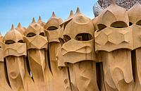 Barcelona, Guadi's The Pedrera (Casa Mila) on the roof with its unusual chimneys, Catalonia, Spain.