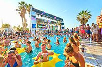 party people enjoying recovery pool party at music festival Starbeach in holiday destination Hersonissos, Crete, Greece