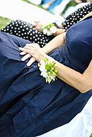 Wedding ceremony: hands of bridesmaids